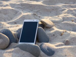 Phone on the beach (from Pixabay)